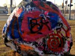 """A large boulder in Romeo known as """"The Rock"""" is where residents have spray-painted messages for years. Happy Birthday messages are the most common, but it also has been used for announcing anniversaries, supporting local sports teams and even making marriage proposals. The Rock is off Van Dyke just south of 31 Mile Road. PHOTO/STEVIE THIEDA"""