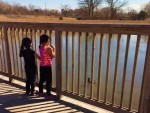 A warm spring day is a good time for two children to watch ducks at George George Park in Clinton Township, Mich. PHOTO/NAOMI LAZARUS