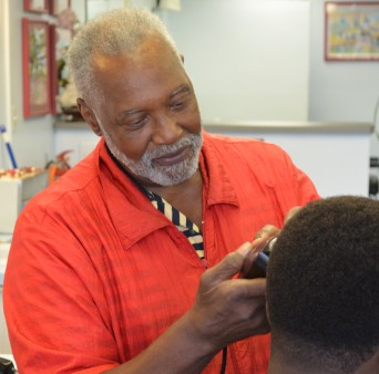 As he has for 46 years, Walter Marshall cuts the hair of a customer. PHOTO/JONATHAN JACKSON
