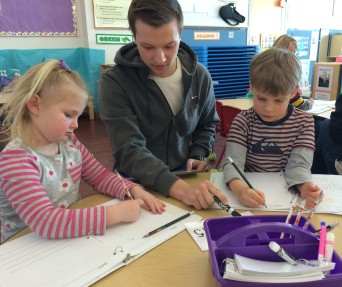 """""""Mr. Mike"""" works with 4- and 5-year-olds at Lowry Center for Early Childhood Education. PHOTO/PAIGE BROCKWAY"""
