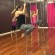 Instructor Melanie Pagel (right) demonstrates moves on the pole as the class follows. PHOTO/BRITTANY SCHOEL