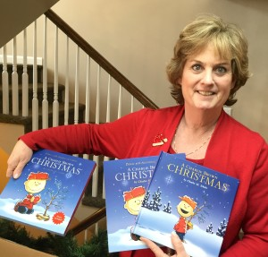 Executive Director Mary Grace McCarter with donated books from Charlotte's Wings. PHOTO/LAUREN BARTHOLD