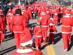 More than 1,000 people dressed in Santa suits turned out for the 2015 Santa Run in Flint, Michigan, a charity fun run/walk to benefit the YMCA.  Similar events happen throughout metro Detroit near Christmas, such as the Santa Hat Hustle on Saturday, Dec. 12, in Hazel Park and the Santa Claus 5k on Thursday, Dec. 24, in Grosse Point Farms. PHOTO/DAVID JACKSON