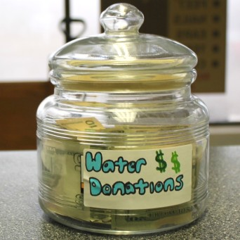 Money collected in the donation jar will help provide Flint pets with clean water./PHOTO JACQUELINE RONDEAU
