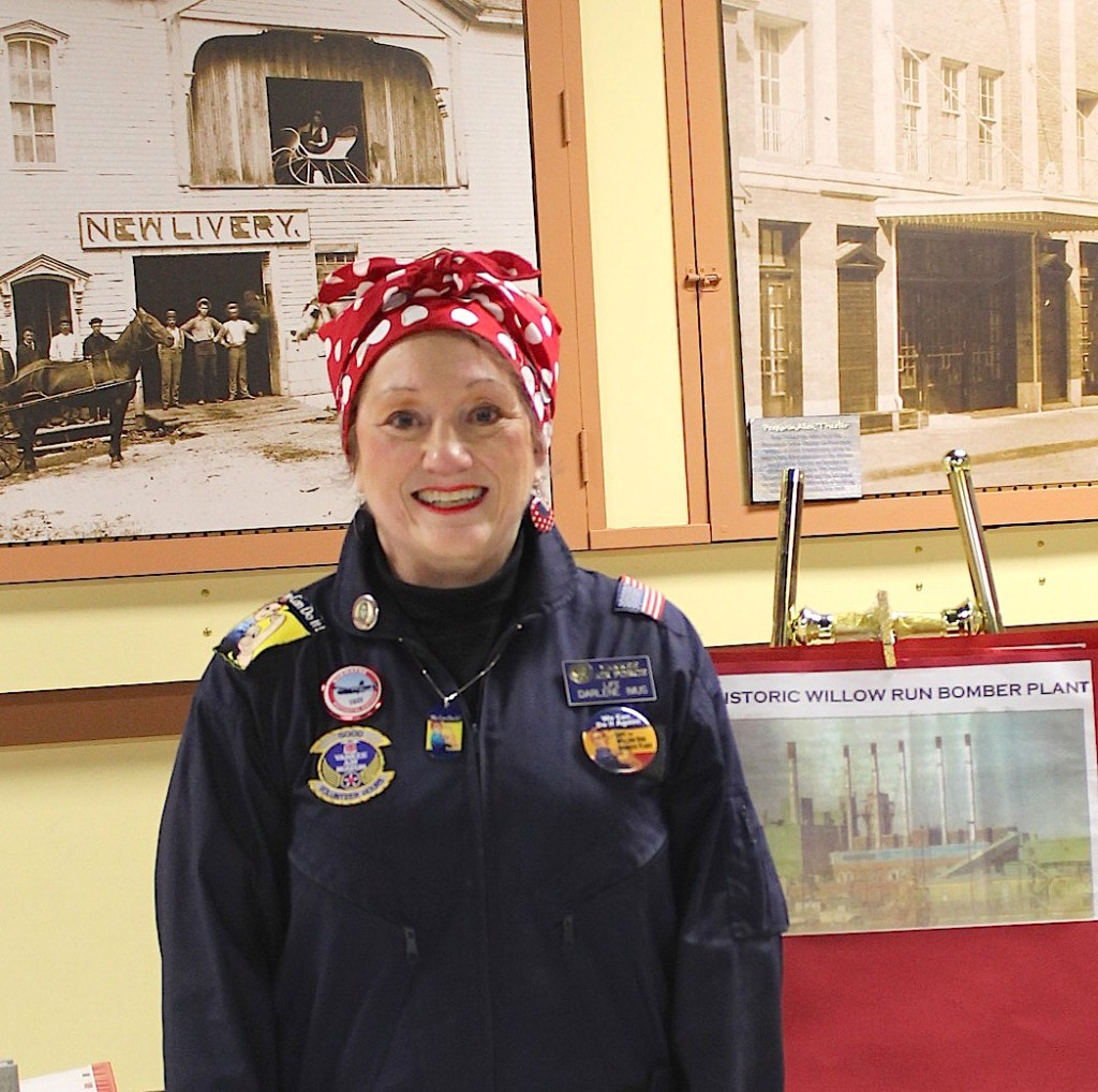 Darlene Imus lead a discussion at the Plymouth Historical Museum on March 8, 2016 for International Women's Day. Dressed as Rosie the Riveter, Imus spoke of the female contribution during World War II. She provided historical photographs of female riveters and aviation plants.  PHOTO/JACQUELINE RONDEAU
