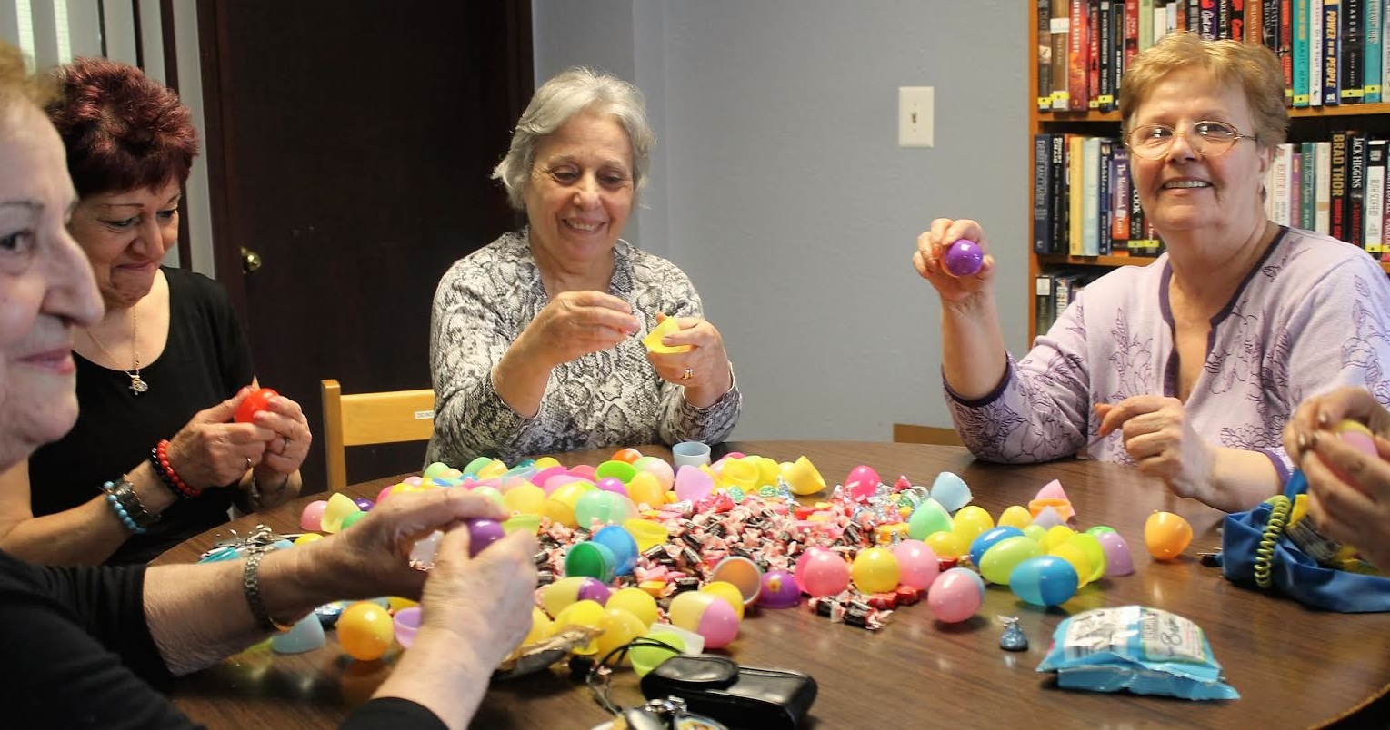 Residents of Walled Lake Villa stuff plastic eggs for the Walled Lake City Easter Egg Hunt. From left: Luma Jabry, Diana Yousif, Rafaa Abodi and Suhair Ayob. Not pictured are Joyce McBride and Virginia Schuman. The event is noon Saturday, March 26, at Hiram Sims Park for children 12 and under. PHOTO/JACQUELINE RONDEAU