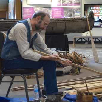 Jim Miller of Willow Winds explained to guests how to build a canoe out of birch bark, white cedar and tar made from pine tree sap mixed with bear fat. PHOTO/JOE BERNHARDT