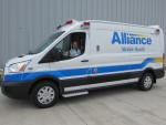 Alliance Medical Co. of Troy recently acquired two vehicles, including this transit van and a traditional box-shaped ambulance. The vehicles were purchased to keep up with increased demand and to replace older trucks. The transit van just came back from being detailed. For Justin Hooks, EMS coordinator at Alliance, the best part of the new paint job is the rear door, which has bright yellow and blue stripes. PHOTO/TAYLOR GOODFELLOW