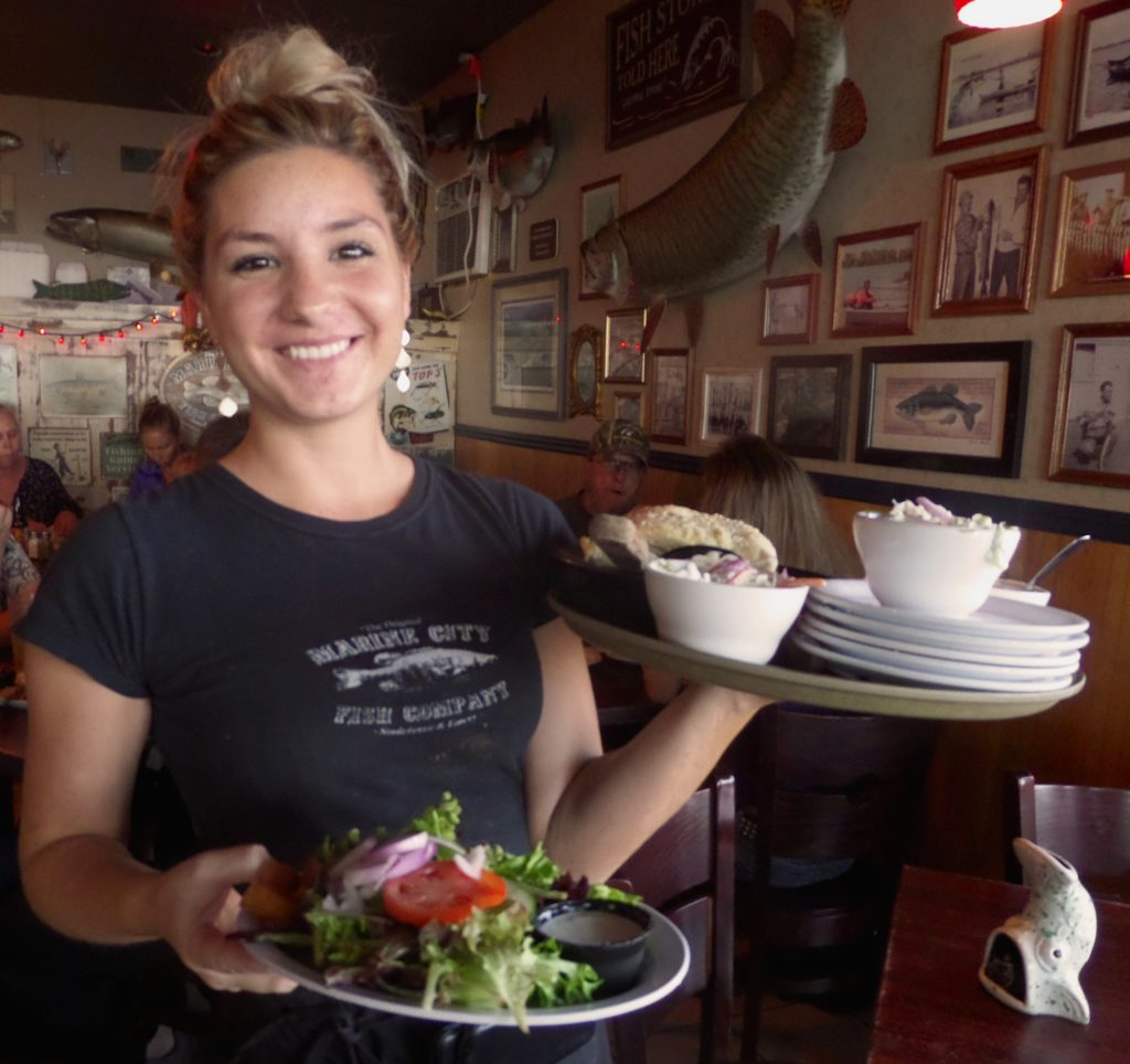 Waitress Cassie Paulun delivers the first course to hungry patrons. PHOTO/COLLEEN KOWALEWSKI