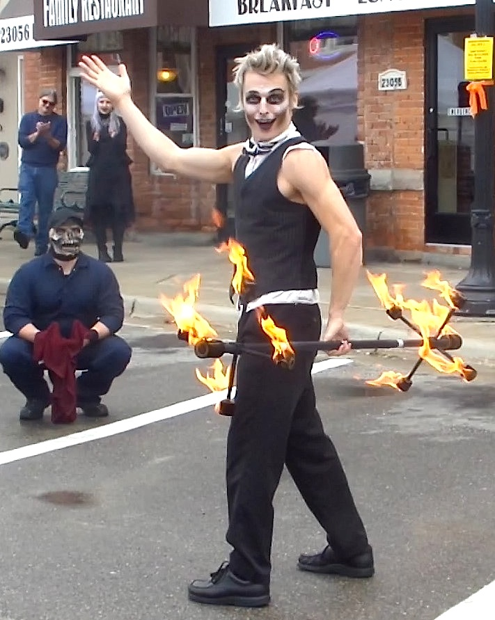 Detroit Circus performer Eric Scott Baker plays with fire for an enthusiastic crowd. He has honed his act, which also includes juggling and face balancing, over seven years as a professional performer. PHOTO/COLLEEN KOWALEWSKI