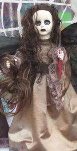 Creepy dolls and witches' hats are on display side-by-side with Tupperware and scented candles in the street fair along Main Street. PHOTO/COLLEEN KOWALEWSKI