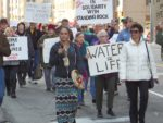 """Kayla Harris, founder of the Wayne State Native American Student Organization, led protesters in a chant of """"Water is life"""" as they marched down Michigan Avenue in Detroit. The march and rally in Campus Martius Park were part of a national day of action in solidarity with the indigenous protesters at Standing Rock, North Dakota. PHOTO/COLLEEN KOWALEWSKI"""