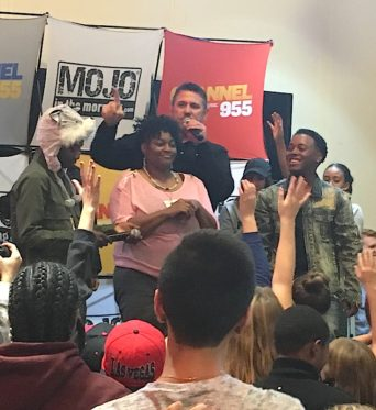 A listener's mom was pulled on stage after being recognized for having the best Juju out of the crowd. PHOTO/CHRISTINA SALEM