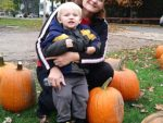 Marsha Parks of Fenton and her grandson, Ace, stopped at a free pumpkin patch at The Road Community Church. The one-day pumpkin patch was at the church's Fenton campus. PHOTO/ALYCIA SEMRAU