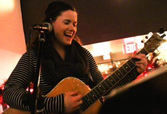 Rachel Williams practices the guitar before her performance at Bologna via Cucina in downtown Rochester. PHOTO/NOWSHIN CHOWDHURY